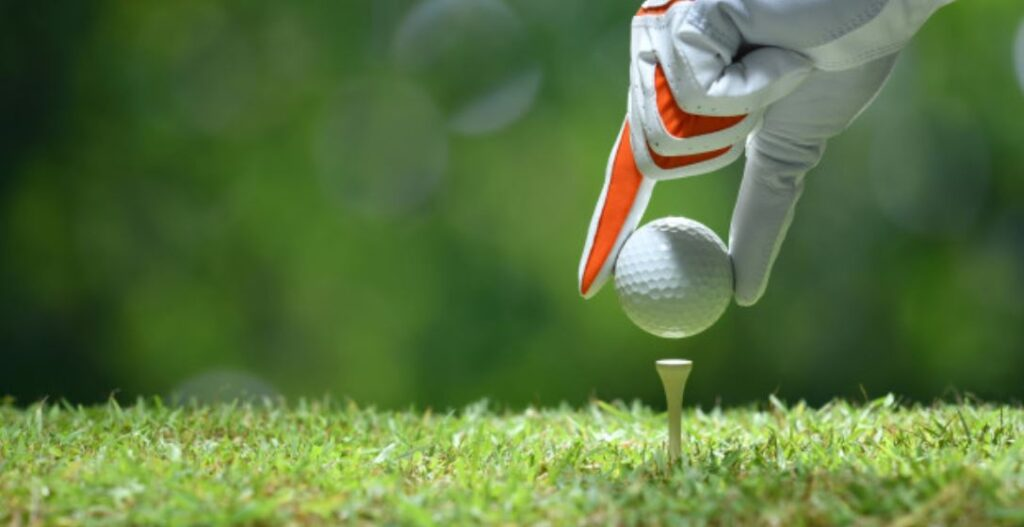 Golftee - Ball mit Handschu